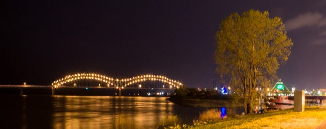 Wide shot of a downtown memphis bridge at night