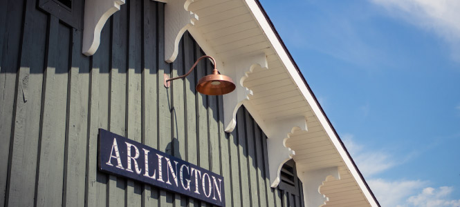 "Close up of a sign on a building that says ""ARLINGTON"""