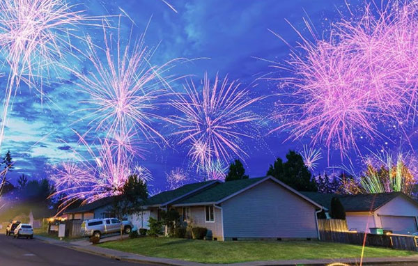 Houses with firework above them