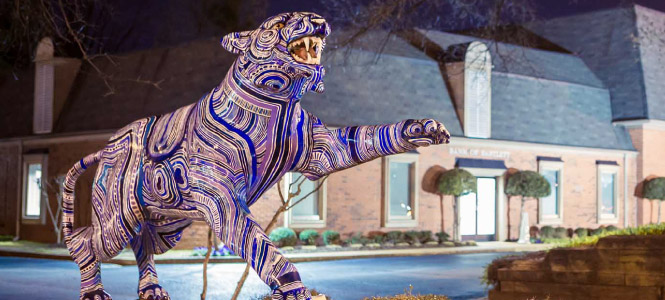 Tiger sculpture outside of a Bank of Bartlett location